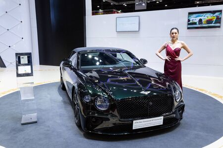 Nonthaburi , Thailand - April 3, 2019: The New Bentley Continental GT Convertible luxury sport car and beautiful pretty girl presented in motor expo Thailand .