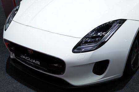 Nonthaburi , Thailand - April 3, 2019: close up headlights front view of Jaguar P 300 F-type white color luxury automobile , modern and classic design super sports car presented in motor show
