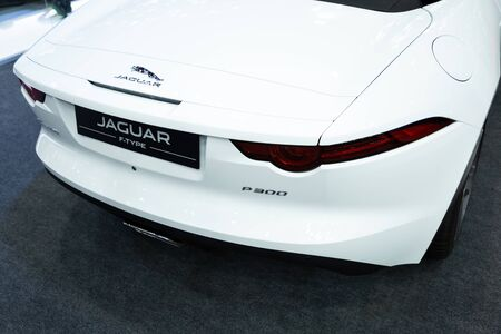 Nonthaburi , Thailand - April 3, 2019: close up taillights rare view of Jaguar P 300 F-type white color luxury automobile , modern and classic design super sports car presented in motor show . Stock Photo - 128141634