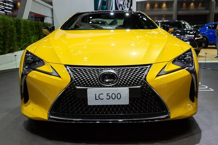 Nonthaburi , Thailand - April 3, 2019: close up front view of Lexus LC 500 yellow car presented in motor show Thailand .