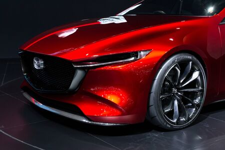 Nonthaburi , Thailand - April 3, 2019: front side view car bonnet , close up headlight and wheel of Mazda red color new collection sports car presented in motor show Thailand .