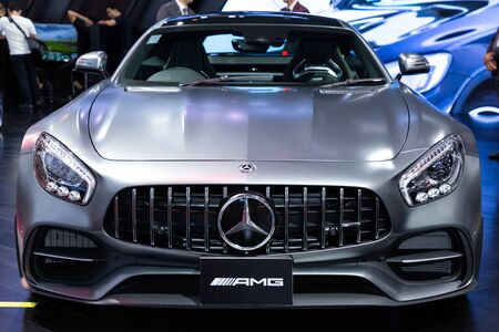 Nonthaburi , Thailand - April 3, 2019: close up front view car bonnet and headlights of Mercedes benz AMG GT C silver color sports car presented in motor show Thailand .
