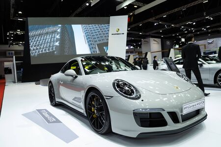 Nonthaburi , Thailand - April 3, 2019 : close up Porsche 911 Carrera 4 GTS luxury super sports car presented in motor show Thailand . Редакционное