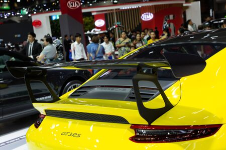 Nonthaburi , Thailand - April 3, 2019 : close up spoiler wing carbon of Porsche the new 911 GT3 RS yellow super sports car presented in motor show Thailand .
