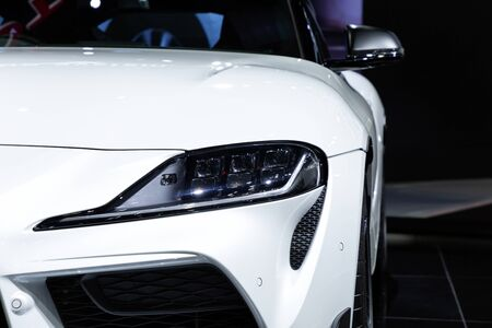 Thailand - April , 2019 : close up headlight front view of Toyota Supra GR sports car presented in motor show Thailand . Editöryel