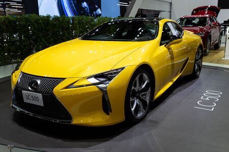 Thailand - April 3, 2019: close up front view of Lexus LC 500 yellow color car presented in motor show Thailand . Editorial