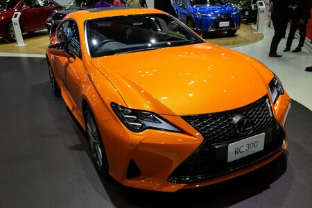 Thailand - April 3, 2019: close up front view of Lexus RC 300 orange color car presented in motor show Thailand . Editöryel