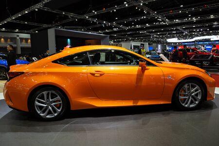 Thailand - April 3, 2019: close up body of Lexus RC 300 orange color car presented in motor show Thailand .
