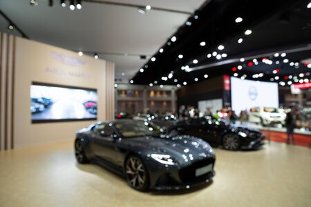 Thailand - April 3, 2019: Blurred Aston Martin luxury car presented in motor show Thailand .