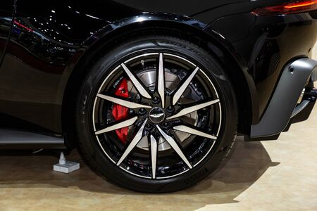 Thailand - April 3, 2019: close up wheel and max alloy of Aston Martin Rapide S luxury car presented in motor show Thailand .