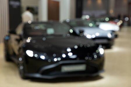 Blurred luxury car presented in motor show Thailand . Editöryel