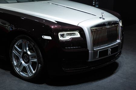 Thailand - April 3, 2019: close up front view headlight and wheel of Rolls Royce luxury car presented in motor show Thailand .