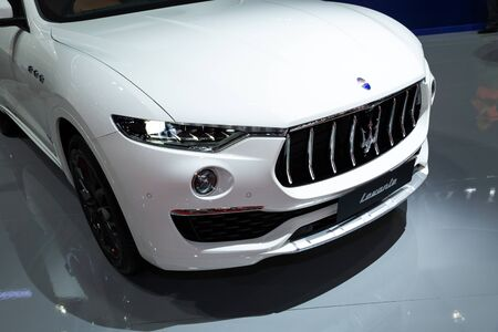 Thailand - April 3, 2019: close up front view headlight of Maserati levante white color luxury car presented in motor show Thailand . Editöryel