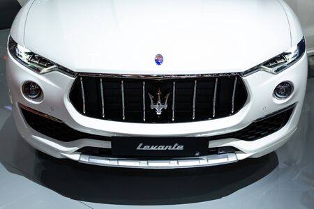 Thailand - April 3, 2019: close up front view of Maserati levante white color luxury car presented in motor show Thailand .