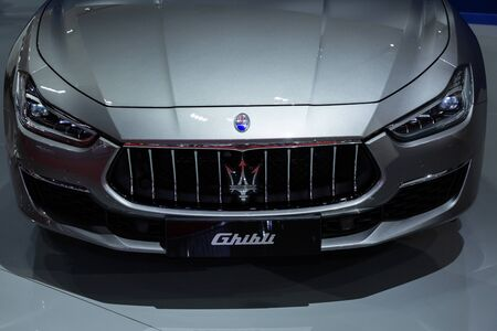 Thailand - April 3, 2019: close up front view of Maserati ghibli grey color luxury car presented in motor show Thailand .