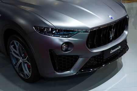Thailand - April 3, 2019: close up front view of Maserati Levante grey color luxury car presented in motor show Thailand . Editöryel