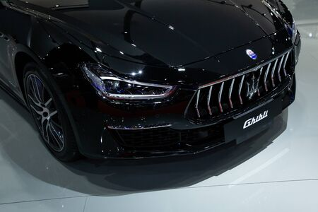 Thailand - April 3, 2019: close up front view headlight of Maserati ghibli black color luxury car presented in motor show Thailand . Editöryel