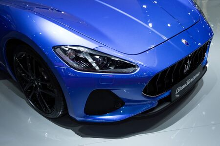 Thailand - April 3, 2019: close up front view headlight of Maserati granturismo blue color luxury car presented in motor show Thailand .