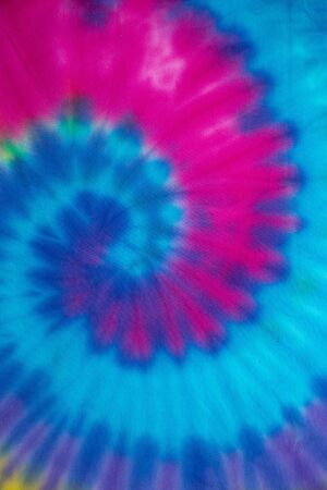 Tie Dye spiral rainbow swirl abstract texture and background , reggae style .