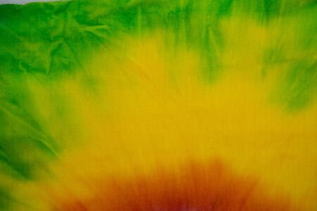 Tie Dye rainbow swirl abstract texture and background , reggae style .