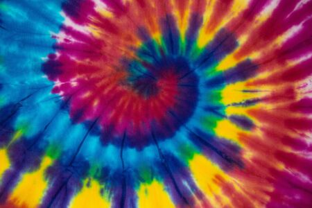 Tie Dye spiral vibrant and gradient rainbow multicolor , hippie shirt pattern . abstract fabric texture and background .