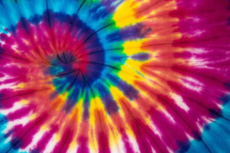 Tie Dye spiral rainbow color , abstract texture and background , reggae style .