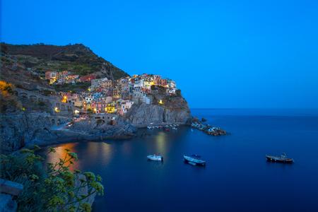 View of Manarola by night, 5 Terre, La Spezia province, Ligurian coast, Italy.