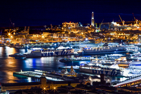 Aerial view of Genoa, Italy, the harbor with lantern (light house) by night / Genoa, October 27, 2016 Italy, Europe