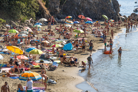 Typical ligurian beach in summertime, full of life and people, in Levanto, La Spezia province near 5 Terre, Italy.