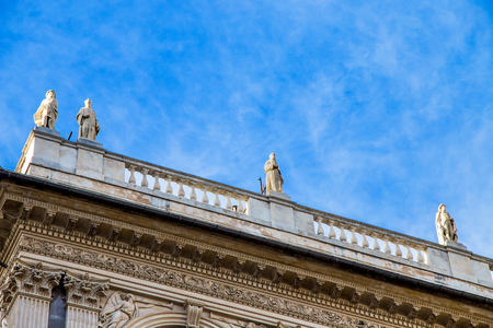 Ancient and historic stone balcony with statues with blue sky background Standard-Bild