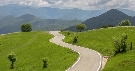 Isolated road in the countryside in spring time around Genoa (Genova) province, Italy.