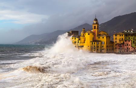 The Church and the wave in Camogli, Genoa, Italy Standard-Bild - 104266903