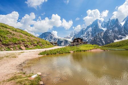 Dolomites Alps in Italy, Pale di San Martino mountains and Baita Segantini with the lake / landscape Фото со стока