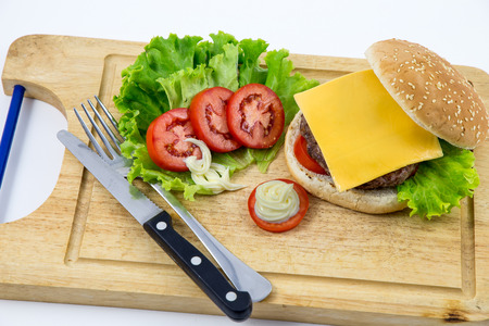 Fresh home-made hamburger served on wood on white background