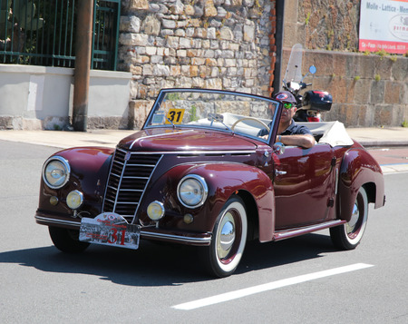 Vintage cars parade around the streets of the city Redakční