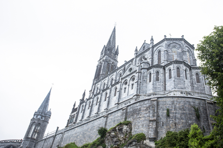 Notre Dame du Rosaire de Lourdes (Basilica of Our Lady of the Rosary) the Roman Catholic church in Lourdes, France, in June 10, 2016 Editorial
