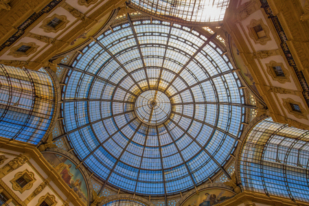 The inner dome of Vittorio Emanuele II Gallery, shopping mall near Duomo Square, Milan, Italy