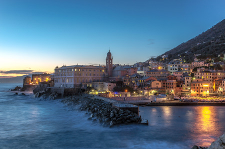 Sunset on seaside village with colorful houses, Genoa, Nervi, Italy Standard-Bild - 104876284