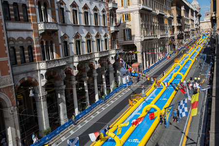 GENOA (GENOVA), ITALY, JULY, 7, 2018 - The longest water slide entered in the Guinness Book of Records showed for the Costa Cruises Festival in Genoa (Genoa) city center, Italy.