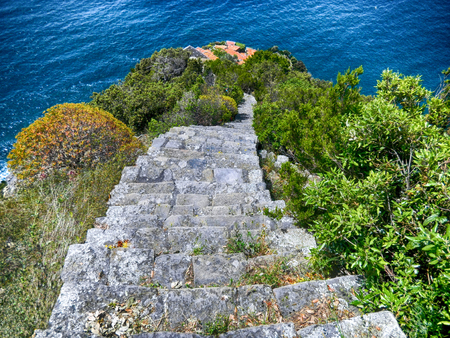 View of the old stone stairway leading to Monesteroli, a small village of fishermen in La Spezia Province, near Cinque Terre, Italy 写真素材