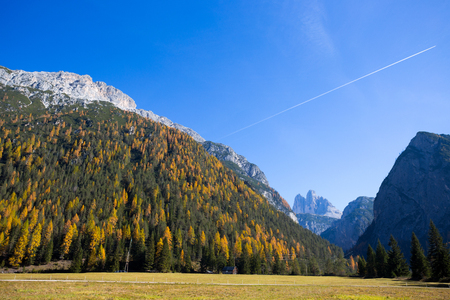View of Tre Cime (Three Peaks) di Lavaredo on the background in autumn time, Dolomites., Italy. Фото со стока