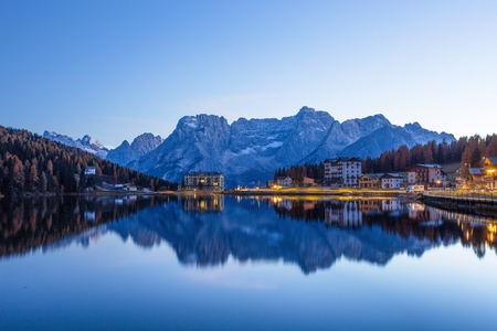 View of Misurina lake just after sunset. Sorapiss mountain on the background. Dolomites, Italy. Archivio Fotografico