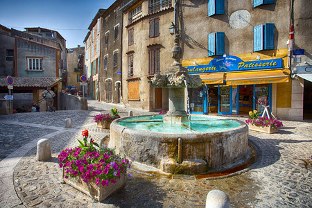 VALENSOLE, FRANCE, JULY, 03, 2015 - The Fountain in the center of the village of Valensole, Provence, France.