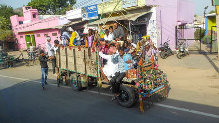 DELHI, INDIA, OCTOBER 18, 2017 - People on a wagon on the streets of Delhi, India. Editorial