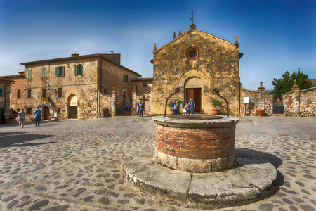 MONTERIGGIONI, ITALY, MAY 5, 2015 - View of the small medieval village with stone walls of Monteriggioni in province of Siena, Tuscany, Italy