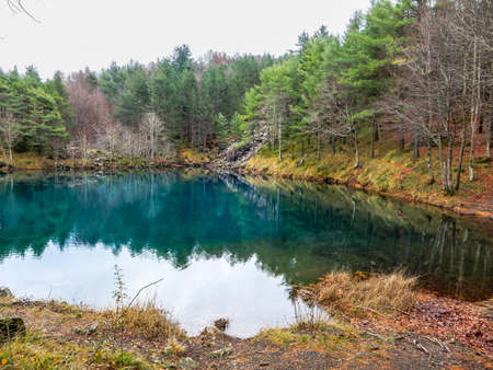 Autumnal landscape of Lame lake, a small mountain pond on Aiona Mount, in the Aveto Regional Natural Park, Italy.