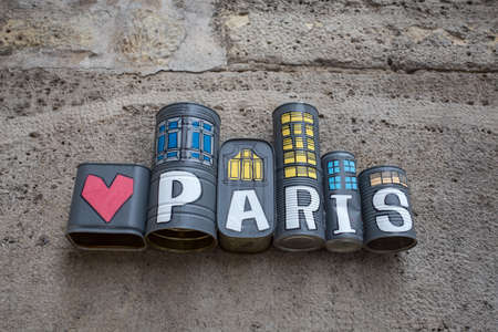 PARIS, FRANCE, SEPTEMBER 6, 2018 - Paris written and painted on tin cans on a wall of Paris, France. Standard-Bild
