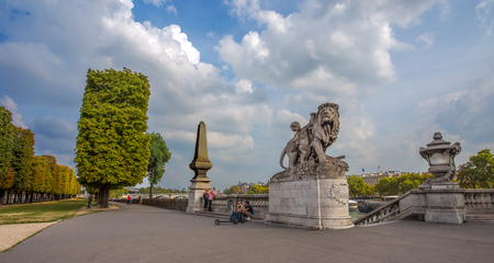 PARIS, FRANCE, SEPTEMBER 5, 2018 - View of Alexander III Bridge over the River Seine, which connects the Grand Palais and the Petit Palais to the Hotel des Invalides in Paris, France Editorial
