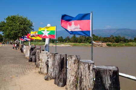 World flags waving at Wat A-Hong Silawas temple, on Mekong river, Tambon Khaisri, Amphoe Bungkan, Nong Khai, Thailand