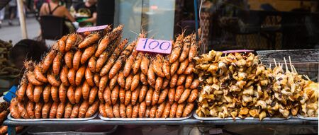 Grilled prawns and squids on the bbq for sale in Bangkok, Thailand